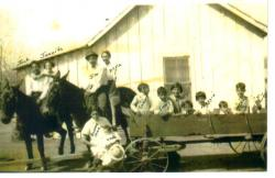 The Gomez Children:  Jack and Juanita Gomez on one horse; Jim Gomez and  Della Leal on the other horse; Bennie Mae  Gome