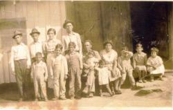 Back Row: standing against the house, left to right, Jack, Jim, Juanita and Joe Gomez; front row:   left to right Sammy,