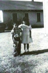 Ernest and Marie Gomez taken in front of their home on Alabama Street in Anadarko,OK;  children of Joe C Gomez and grand