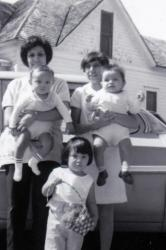 Anita Gomez Toyekoyah, twins Randy and Robert with Gloria, her sister. Anita and Gloria are the daughters of Jim C Gomez