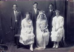 George R Gomez of Anadarko, OK, first man on the left, at his youngest sisters wedding, Augustina Gomez Robles.